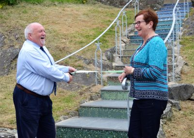 Councillor Phil Baker and Solva Care Trustee and Mosaic Project Organiser Sue Denman cut the ribbon